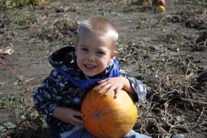 Blake holds a pumpkin