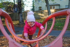 My daughter Julia, just two, climbs the ladder at the playground.