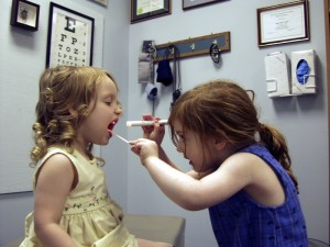 two girls playing at a doctor's office