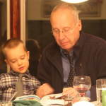 Blake and Granddad read the Children's Bible together.